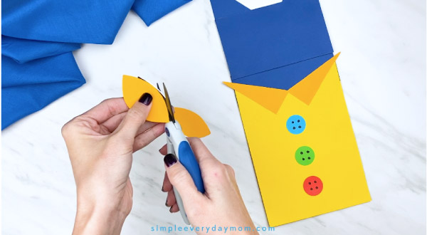 hands trimming paper Pete the Cat eyes