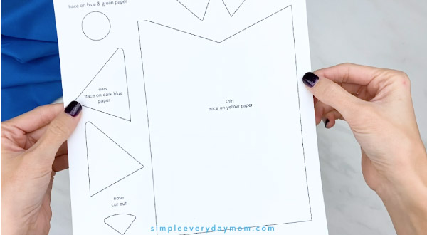 hands holding Pete the Cat craft template