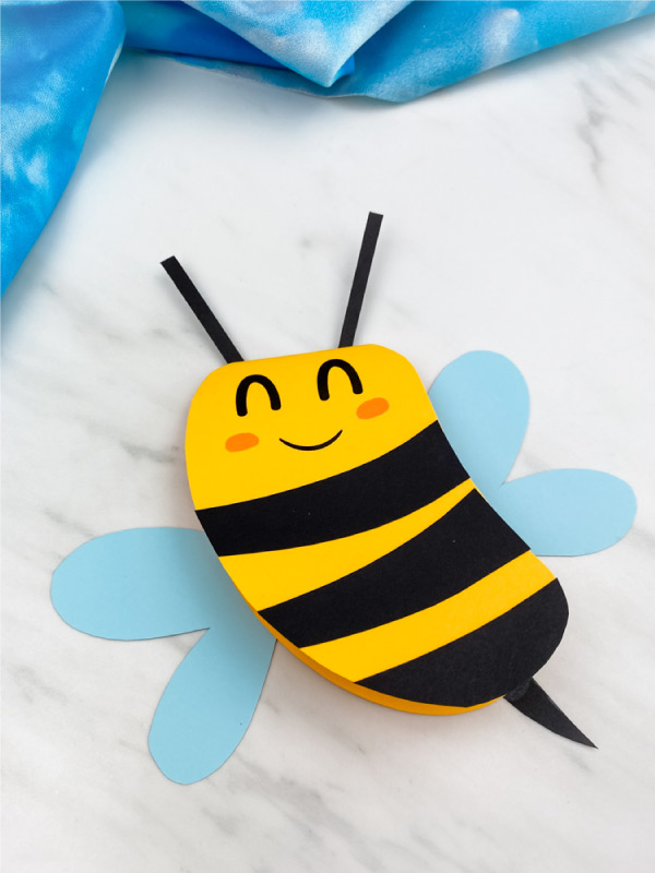 Closeup of paper bee card craft