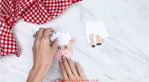Hands gluing fluff onto paper sheep card craft