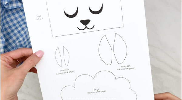 Hands holding paper bag sheep craft template