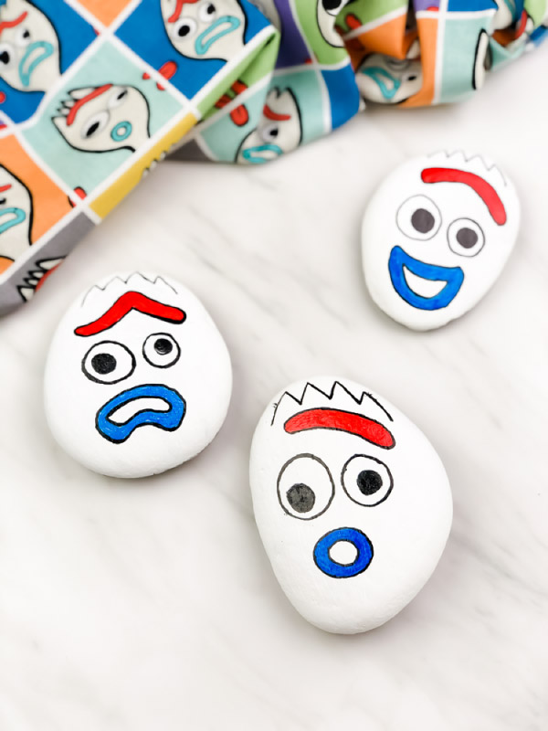 3 forky painted rocks with different emotions
