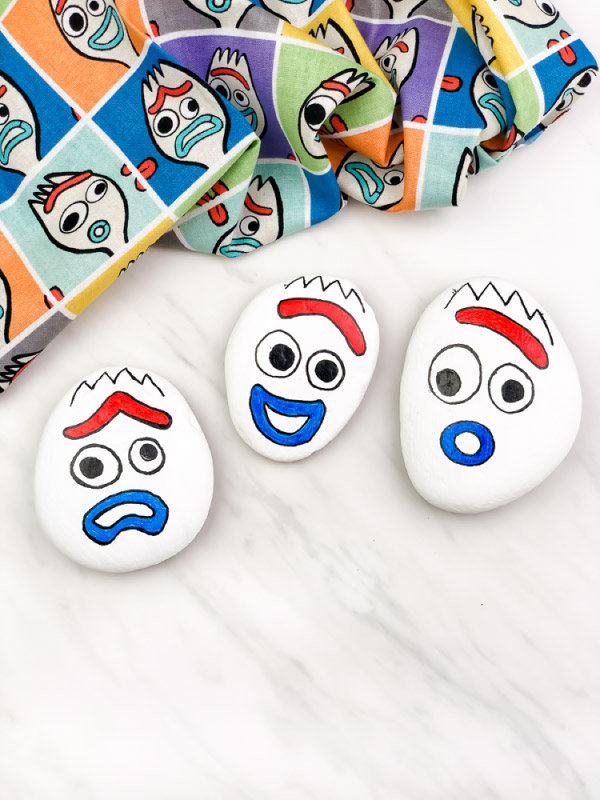 3 forky rocks with different emotions