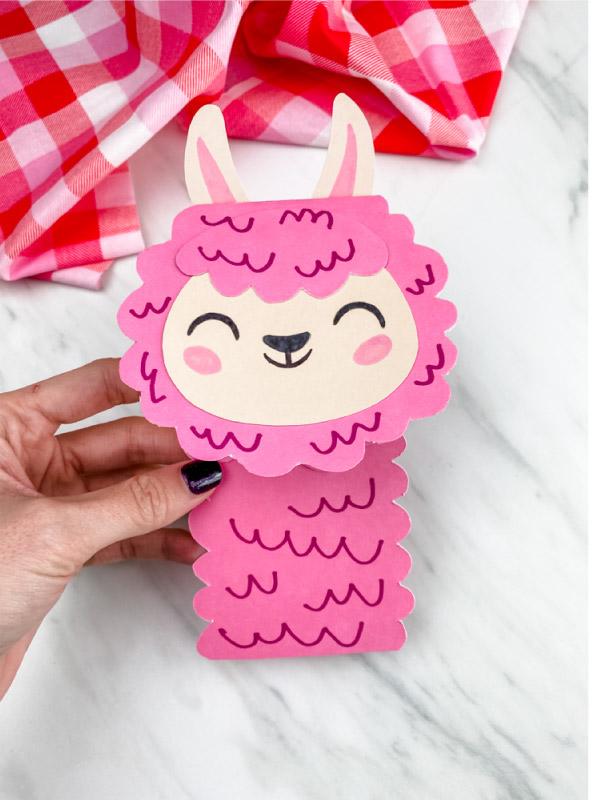 Hand holding llama valentine card craft