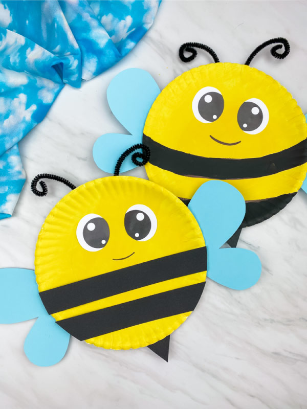 Two paper plate bees