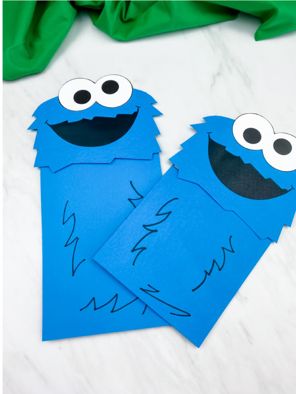 closeup of two cookie monster paper bag puppet crafts