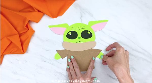 hands gluing on Yoda's hands