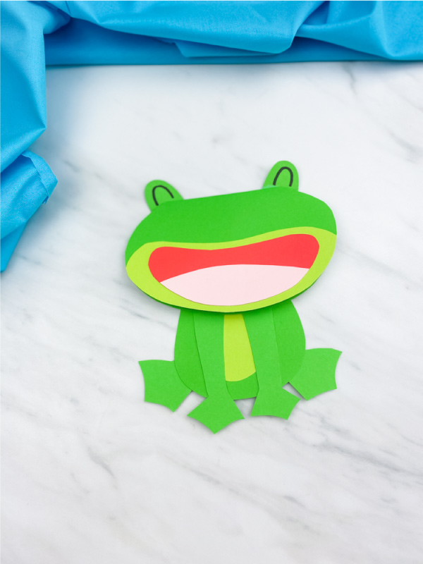 single frog card on marble table