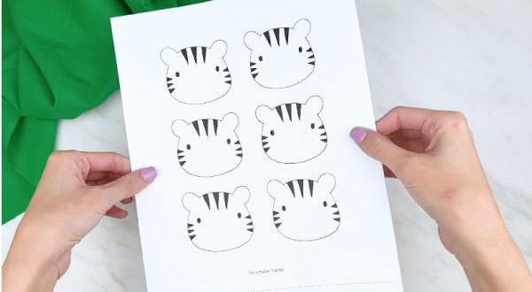 hands holding handprint tiger craft template