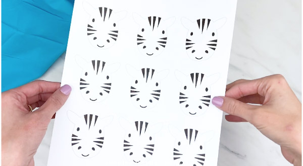 hand holding zebra craft template