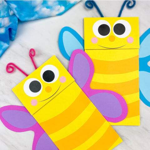 two paper bag butterfly puppets