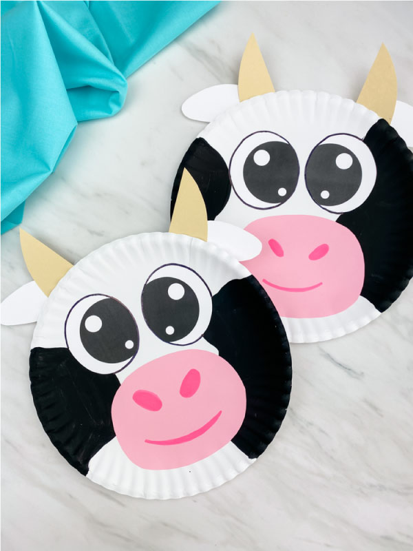 two paper plate cows