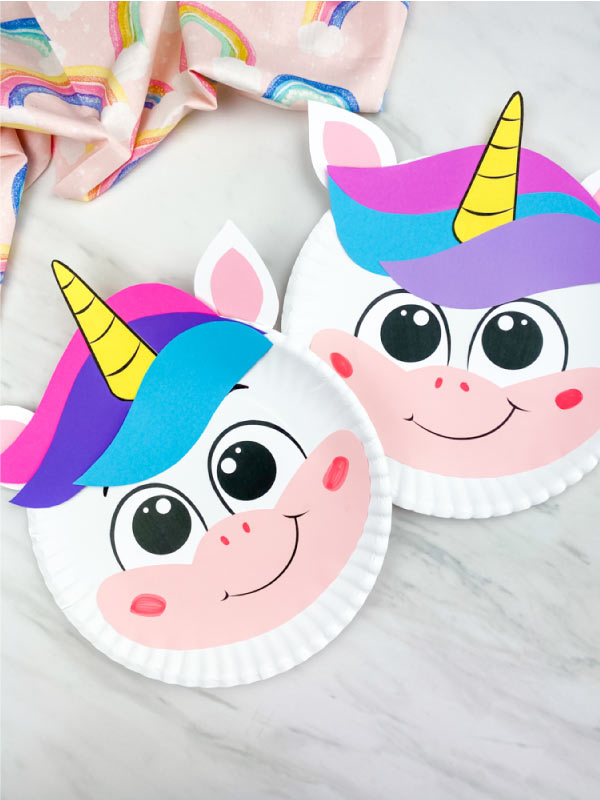 closeup of two paper plate unicorn crafts