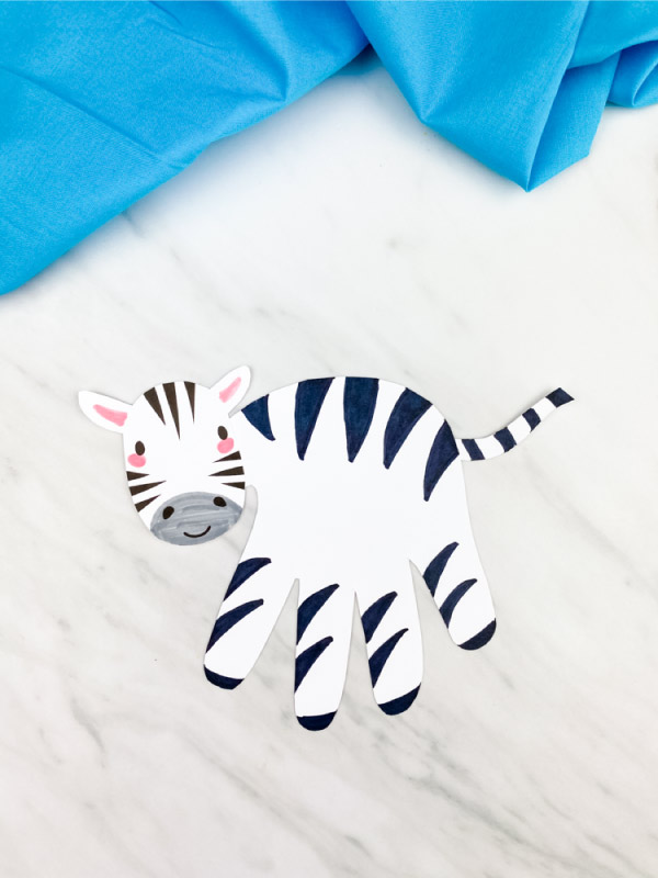hand print zebra on marble background with blue fabric