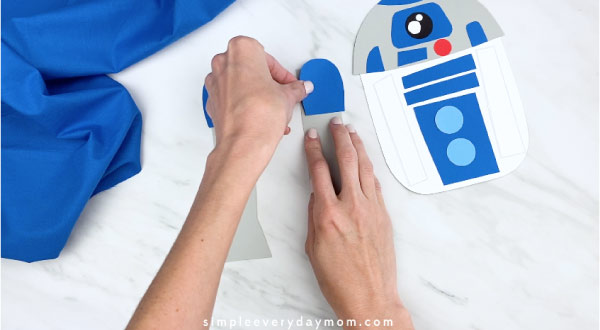 hands gluing top of R2D2 leg