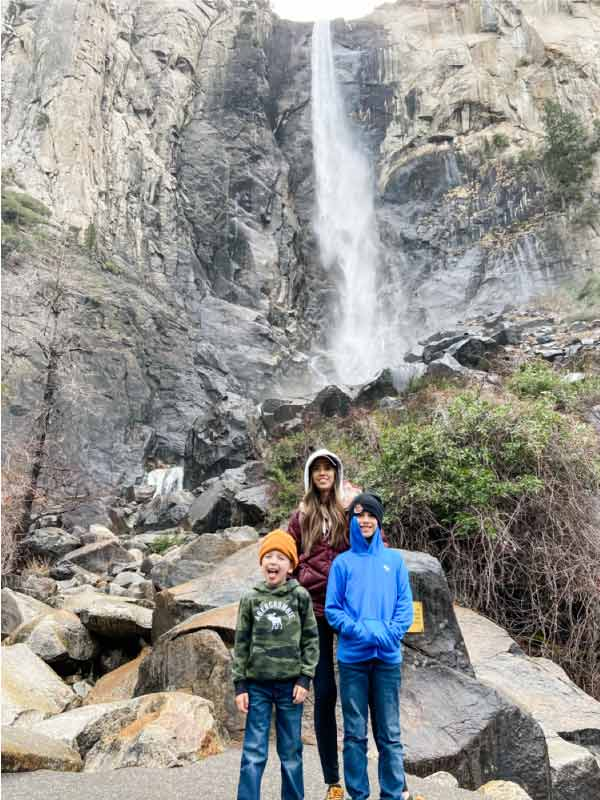 Mom with two kids at Bridalveil falls at Yosemite