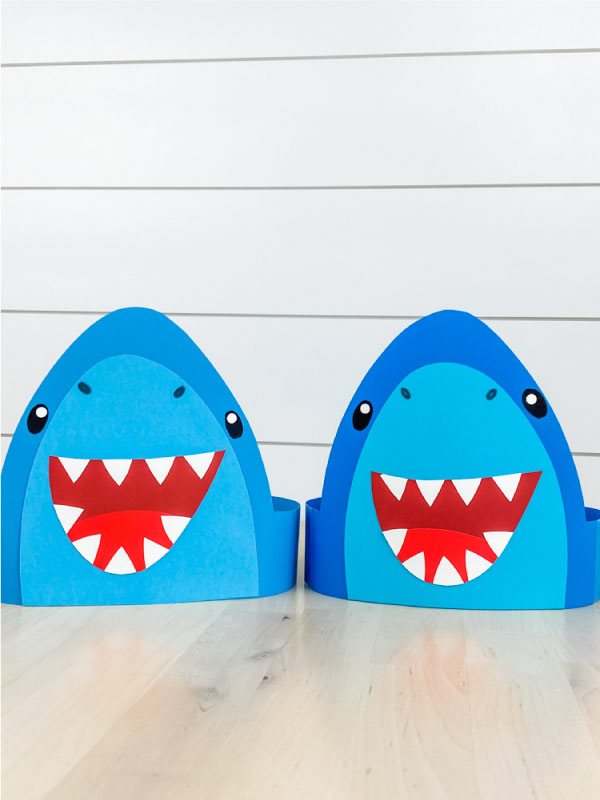 one light blue shark headband craft and one darker blue shark headband craft