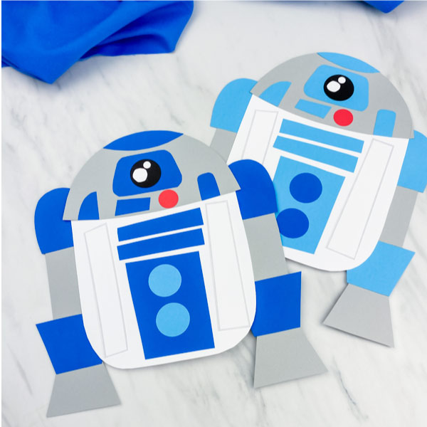 two paper R2D2 crafts in dark blue and light blue