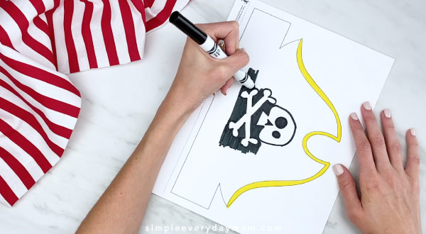 hands coloring in pirate headband black