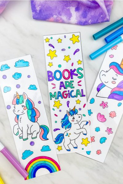 3 unicorn coloring page bookmarks with markers