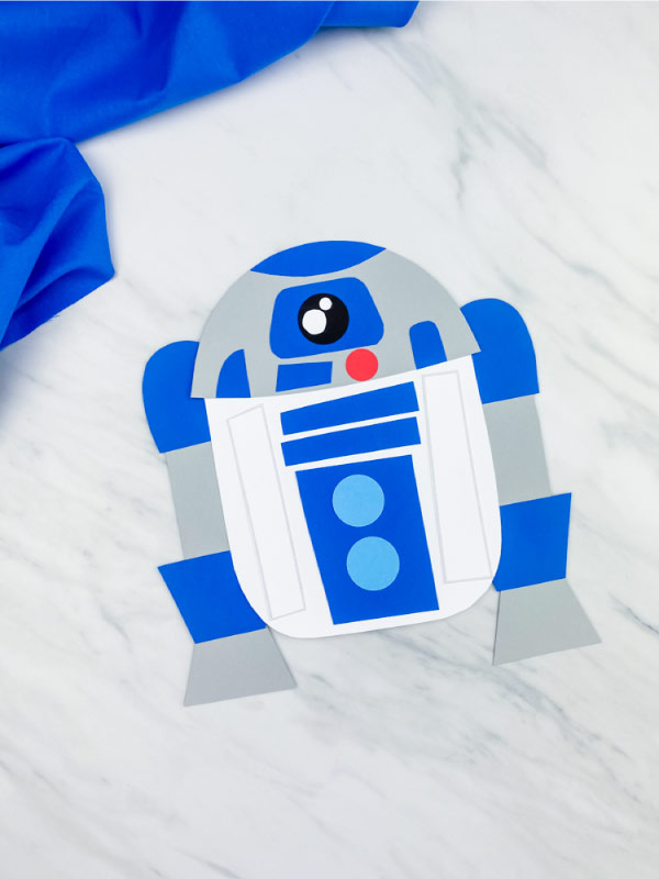dark blue r2d2 paper craft on marble background