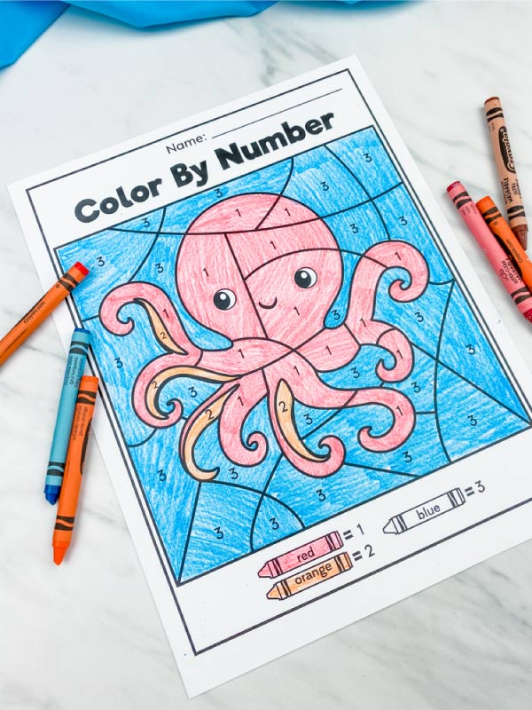 octopus color by number with crayons scattered around it