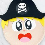 closeup of paper plate pirate boy with blonde hair