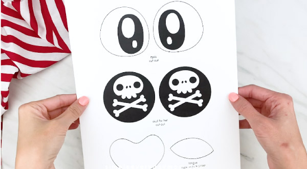 hands holding paper plate pirate template