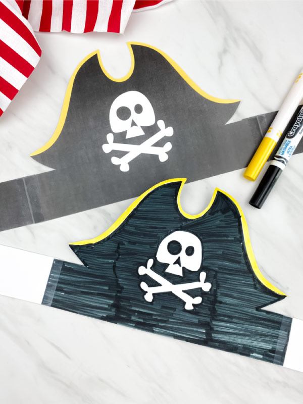 two paper pirate headbands with markers