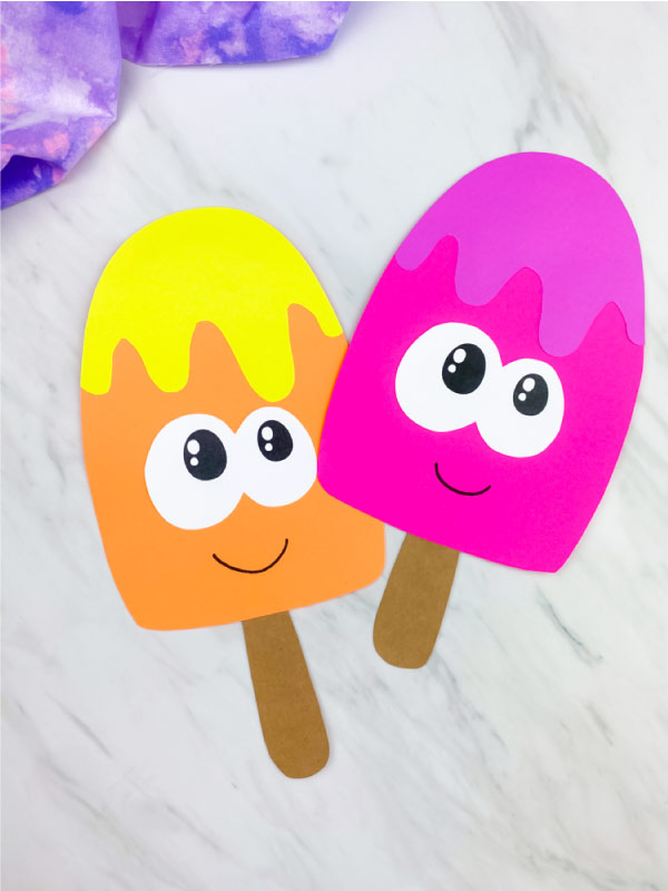 two ice cream paper crafts on marble background