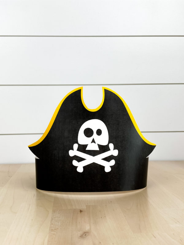 one black and yellow paper pirate headband