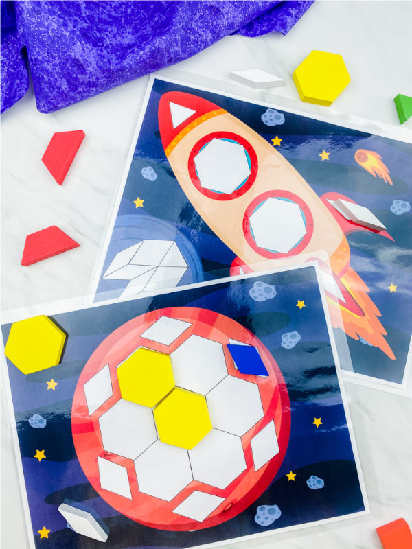 spaceship and planet pattern block mats with pattern blocks scattered around