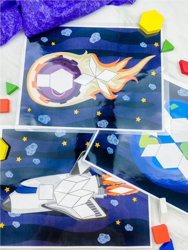 comet, earth and spaceship pattern block mats with pattern blocks scattered
