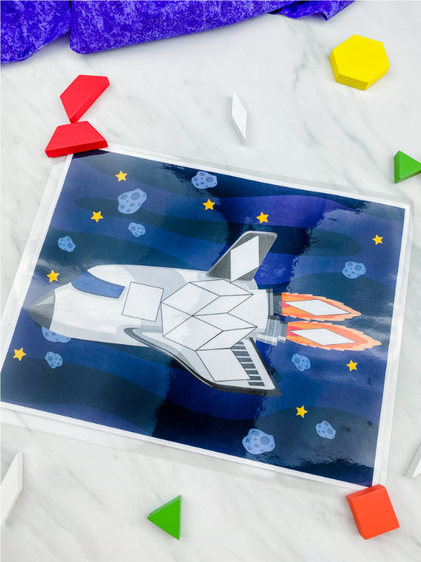 spaceship pattern block mat with pattern block mats scattered around