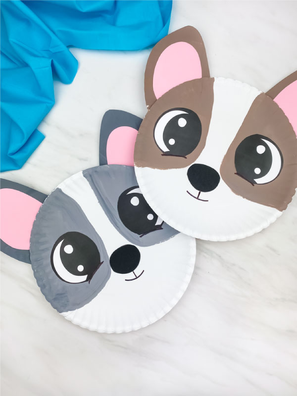gray paper plate dog craft with brown paper plate dog craft stacked slightly on top