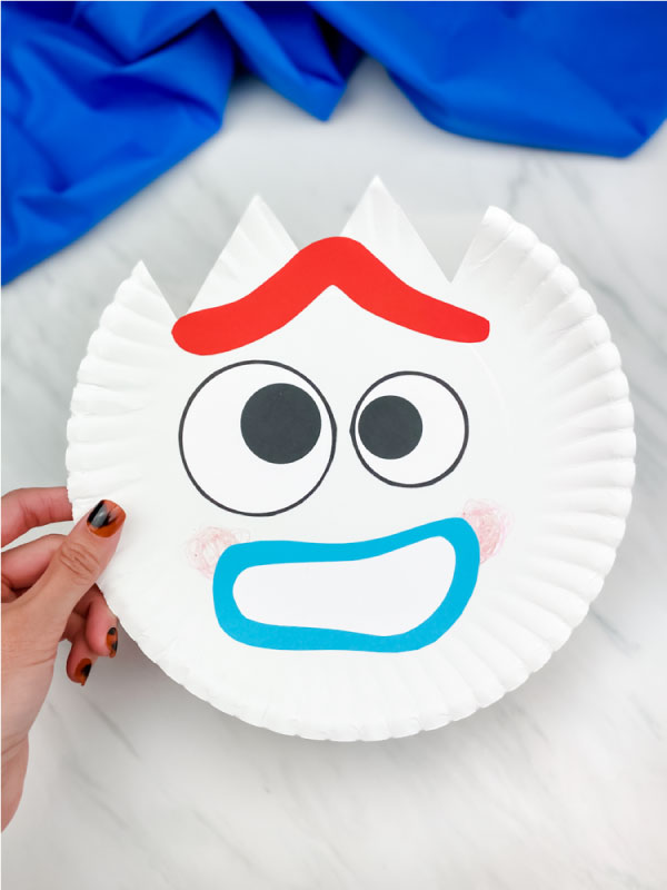 hand holding worried paper plate forky craft