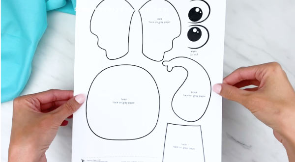 hands holding elephant paper craft template