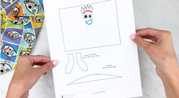 hands holding Forky craft template
