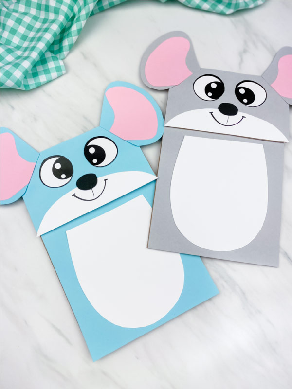 blue and gray mouse puppet craft on marble background with green checkered fabric
