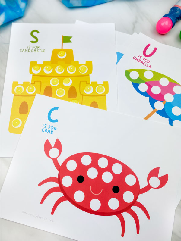 crab, sandcastle and umbrella dot marker printables with dot marker on marble background