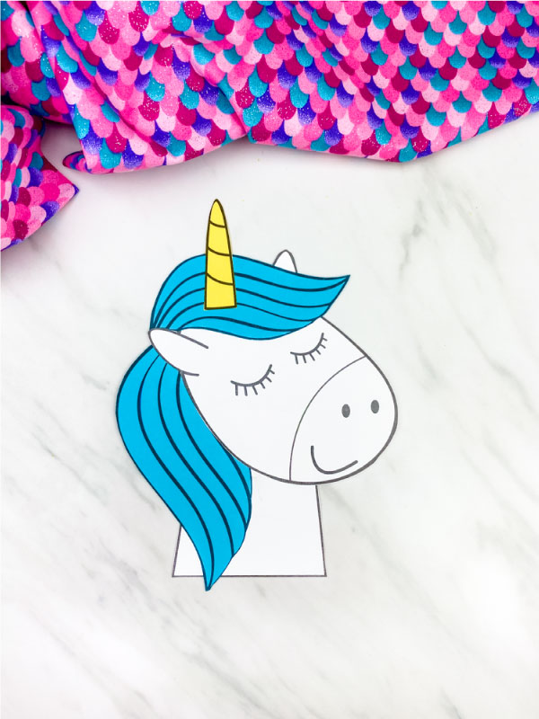 blue maned unicorn with marble background and colorful fabric