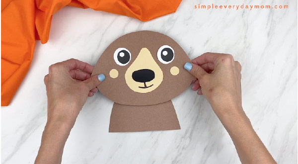 hands gluing on paper bear head to bear body