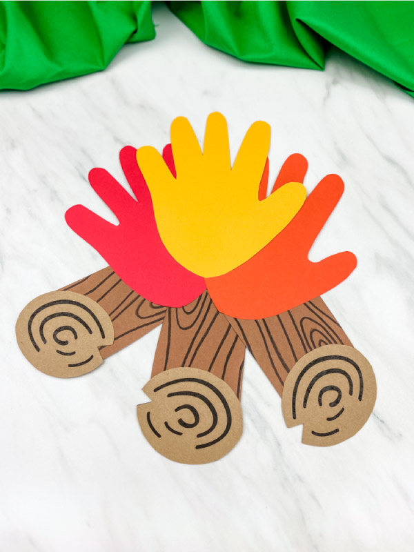 handprint campfire craft made from brown paper and red, yellow and orange paper handprints