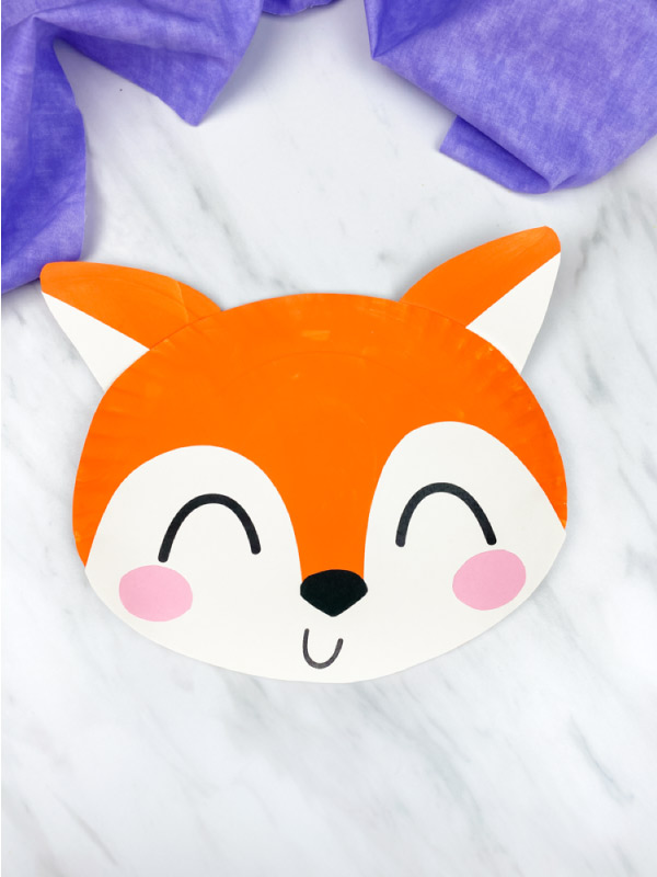 paper plate fox on marble background with purple fabric