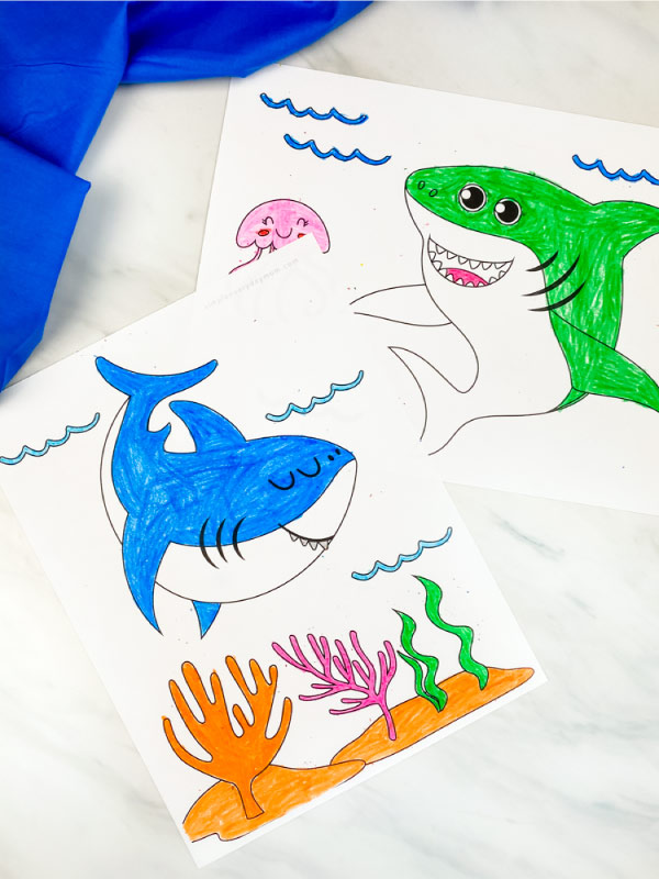 blue and green great white shark coloring pages on marble background with blue fabric