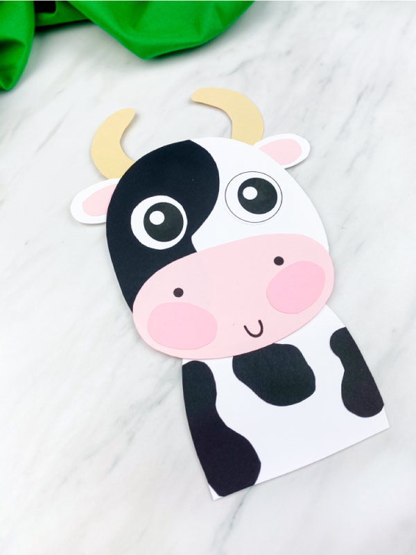 closeup of black and white paper cow