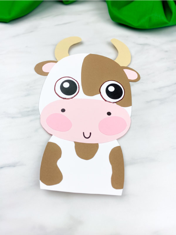 closeup of brown and white cow craft