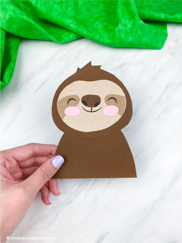 hand holding paper sloth craft