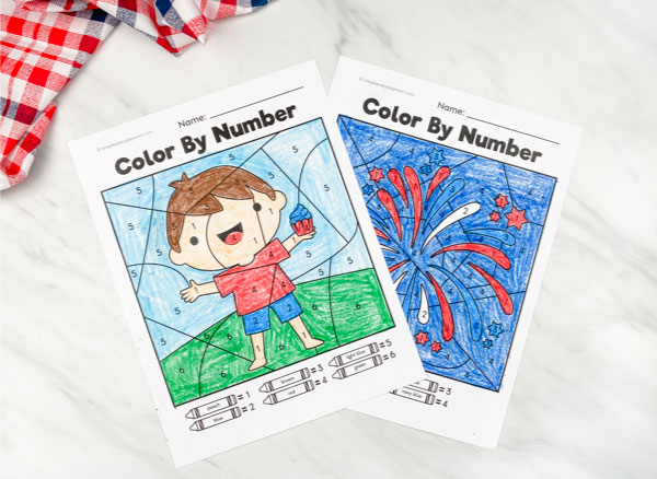 patriotic boy and fireworks color by number worksheets colored in on marble background