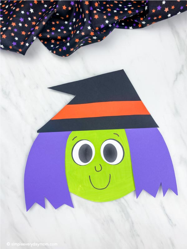 light green and purple haired paper plate witch